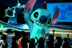 "0620AU_0369JD.jpg 0620AU_0383JD.jpg SAY HELLO TO 'STITCH': In this photo taken inside ""Stitch Encounter,"" the tiny and talkative alien known as ""Stitch"" waves to guests as they enter Space Control Traffic Center at Hong Kong Disneyland.  The mischievous blue alien, who debuted in Disney's hit animated comedy ""Lilo & Stitch,"" stars in the new cutting-edge attraction where park guests, seated in an intimate theatre, carry on real-time conversations with the famous animated character.  The jaw-dropping technology allows for Disney fun like never before.  Stitch, aka ""Experiment 626,"" can talk to guests, play games and interact with them in surprising new ways.  When it officially opens to guests July 13, 2006, Stitch Encounter will be presented daily in three languages – Cantonese, English and Putonghua.  Hong Kong Disneyland is the first and only Disney theme park in the world where guests can experience Stitch Encounter. (Jimmy DeFlippo, photographer)"